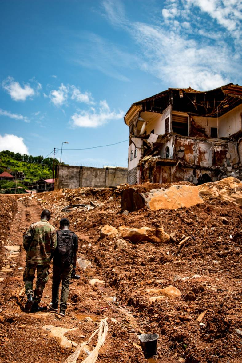 Mudslide in Sierra Leone - destroyed house on top of hill - When disaster meets conflict